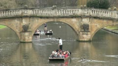 Punting on the River Cam by Clare Bridge, Cambridge, UK Stock Footage