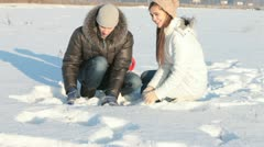 Couple throwing snow Stock Footage