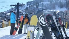 Skis and Snowboards on a rack at the resort lodge Stock Footage
