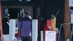Skiers and snowboarders waiting in line for the ski lift Stock Footage