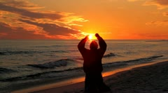 Man Kneeling At Sunset Stock Footage