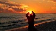 Man Kneeling At Sunset Stock Footage