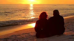 Couple Watching Sunset Stock Footage