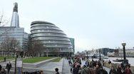 People walking near City Hall, Shard London Bridge, The Shard, Thames River Stock Footage