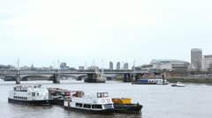 Hungerford Bridge and Golden Jubilee Bridge in London, England, Thames River Stock Footage