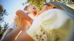 Caucasian Mother and Baby Tender Kiss Stock Footage