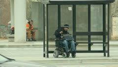 Handicapped man waiting for the bus2 Stock Footage