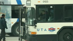 People waiting at the bus stop 2 - stock footage