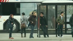 People waiting at the bus stop 3 - stock footage