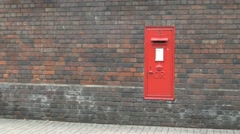 Red Royal Mail Letter Box in Brick Wall Stock Footage