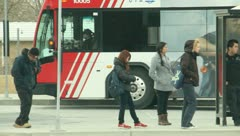 People waiting at the bus stop 5 - stock footage