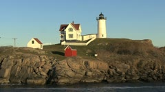 Maine Nubble Lighthouse and red oil house hx Stock Footage