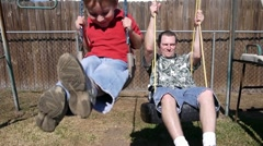 Kids swing with Dad - stock footage