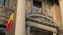 Stock Exchange Building (La Bourse de Bruxelles) in Brussels, Belgium Flag Stock Footage