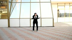 Business man jumps Stock Footage