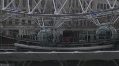 People going in and going out of London Eye Stock Footage