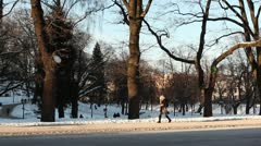 People walking by in park ProRes Stock Footage