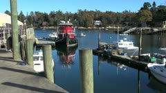 Maine Robinson Wharf with red tug boat sx Stock Footage