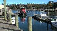 Stock Video Footage of Maine Robinson Wharf with red tug boat sx