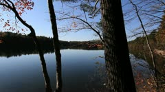 Massachusetts Walden Pond & trees cx Stock Footage
