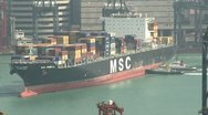 Stock Video Footage of Container Ship Maneuvering In Port Close Up