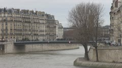 People walking on a bridge in Paris Stock Footage