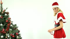 Female Santa smiles and winks Stock Footage