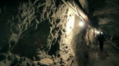 Walk in mine tunnel Stock Footage