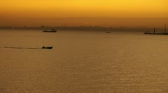 Silhouette fisher boat Stock Footage