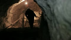 Miner ascending in mine Stock Footage