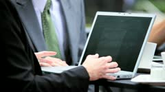 Business People Using Laptop at Outdoor Café Stock Footage