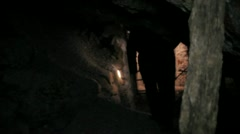 Man exploring mine Stock Footage