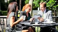 Stock Video Footage of Business People Using Laptop Outdoor Café