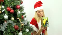 Blonde with Christmas presents Stock Footage