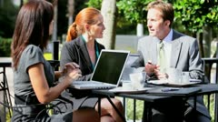 City Business Colleagues Drinking Coffee Outdoors - stock footage