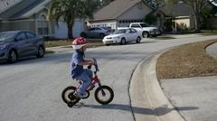 Little boy riding bike Stock Footage