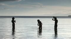 Filipino children casting fishing lines Stock Footage