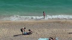 People on Kaputas beach top view zoom out Stock Footage