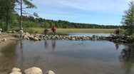Minnesota tourists at Lake Itasca Mississippi headwaters Stock Footage