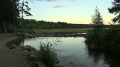 Minnesota Lake Itasca Mississippi River headwaters in evening Stock Footage