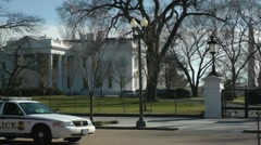 White house with Executive Police car, zooms out wider. - stock footage