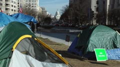 Occupy DC Freedom Plaza, Capitol in distance Stock Footage