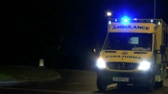 Ambulance on Emergency Call into Addenbrooke's Hospital, Cambridge, UK Stock Footage