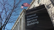 Stock Video Footage of IRS Headquarters, sign with flag, Washington, DC