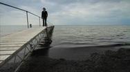 Woman Walking along Jetty into the Baltic Sea, Denmark GFHD Stock Footage