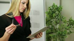Businesswoman with tablet thinking Stock Footage