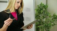 Stock Video Footage of businesswoman with tablet thinking