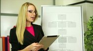 Stock Video Footage of businesswoman using a tablet and chart