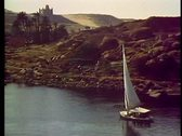 Stock Video Footage of A felluca sailboat on the Nile River at Aswan, Egypt 108001