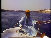 Stock Video Footage of A Nubian boy guides a felluca down the Nile at Aswan